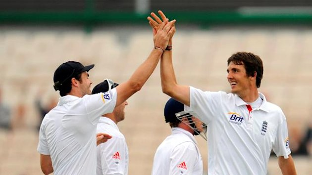 England's Finn is congratulated by Anderson after dismissing Bangladesh's Imrul Kayes during the second cricket test