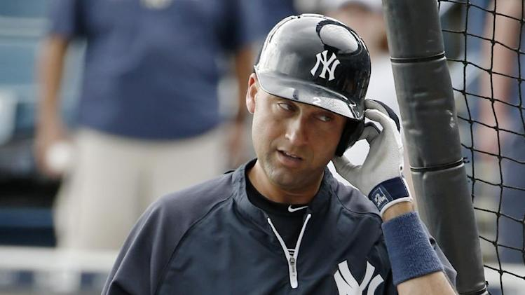 New York Yankees' Derek Jeter heads into the batting cage before rain interrupted the session prior to a spring exhibition baseball game against the Detroit Tigers in Tampa, Fla., Wednesday, March 12, 2014