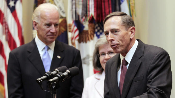 FILE - In this Sept. 6, 2011, file photo, new CIA director David Petraeus, right, accompanied by his wife Holly Knowlton Petraeus and Vice President Joe Biden, speaks following his swearing-in ceremony, in the Roosevelt Room of the White House in Washington. Petraeus has resigned as director of the CIA after admitting he had an extramarital affair. (AP Photo/Pablo Martinez Monsivais, File)