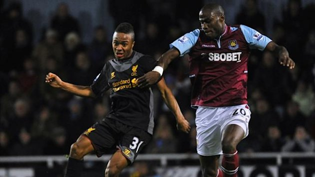 West Ham's Guy Demel (R) tackles Liverpool's Raheem Sterling (Reuters)