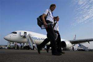 Visitors walk past an Airbus A350 on display at the Singapore Airshow