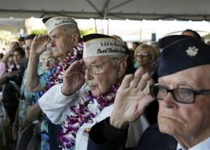 """Smith salutes during the """"Moment of Silence"""" while attending the 72nd anniversary of the attack on Pearl Harbor, in Honolulu"""