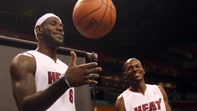 Miami Heat basketball players LeBron James, left,  and Ray Allen wait for their turn to have their pictures taken during the team's NBA media day in Miami, Friday, Sept. 28, 2012.  (AP Photo/Wilfredo Lee)