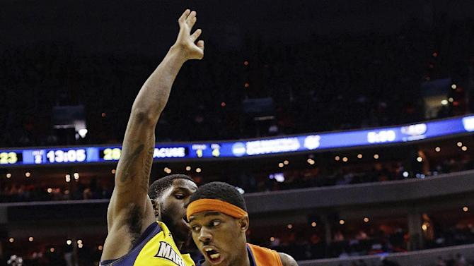 Syracuse forward C.J. Fair (5) drives past Marquette forward Jamil Wilson (0) during the second half of the East Regional final in the NCAA men's college basketball tournament, Saturday, March 30, 2013, in Washington. (AP Photo/Pablo Martinez Monsivais)