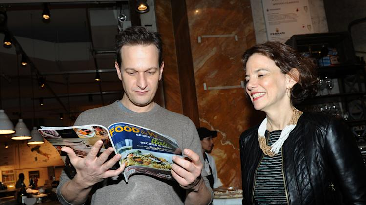 Actor Josh Charles, left, and FOOD & WINE editor in chief Dana Cowin celebrate the Mario Batali guest-edited April issue of FOOD & WINE during a party at Eataly in New York, Wednesday, March 6, 2013.  (Photo by Diane Bondareff/Invision for FOOD & WINE/AP Images)