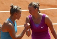 Kvitova of the Czech Republic shakes hands with Bratchikova of Russia after winning her match during the French Open tennis tournament at the Roland Garros stadium in Paris