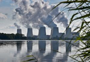 Smoke rises from the cooling towers of Vattenfall's…