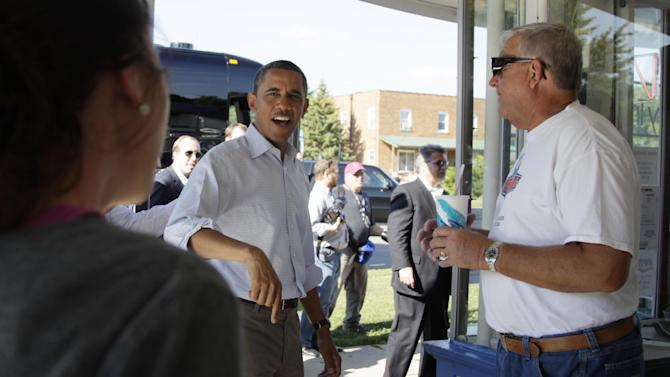 President Barack Obama greets people at DeWitt Dairy Treats, Tuesday, Aug. 16, 2011, in DeWitt, Iowa, during his three-day economic bus tour. (AP Photo/Carolyn Kaster)
