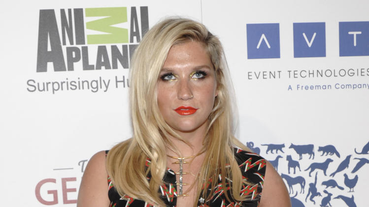 "FILE - This March 24, 2012 file photo shows singer Kesha at The 26th Annual Genesis Awards benefiting The Humane Society in Beverly Hills, Calif. The million-selling singer-songwriter has signed with Touchstone for the illustrated memoir ""My Crazy Beautiful Life,"" scheduled to come out Nov. 20, shortly before her new album, ""Warrior.""  (AP Photo/Dan Steinberg, file)"