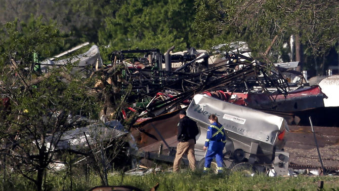 Emergency workers patrol the scene Saturday, April 20, 2013, three days after an explosion at a fertilizer plant in West, Texas. The massive explosion at the West Fertilizer Co. Wednesday night killed at least 14 people and injured more than 160. (AP Photo/Charlie Riedel)