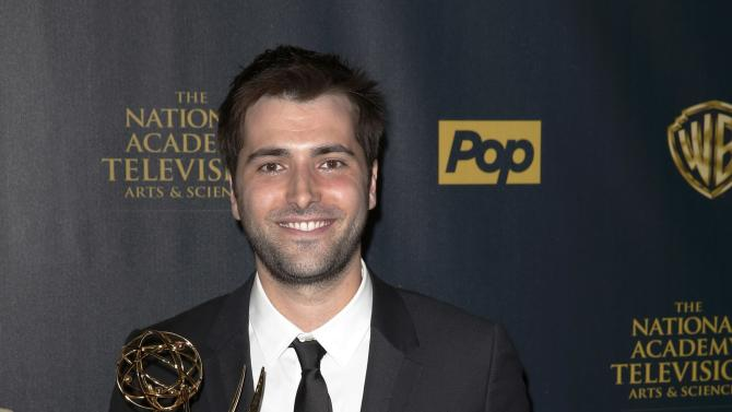 Actor Freddie Smith poses backstage with his award for Outstanding Younger Actor in a Drama Series at the 42nd Annual Daytime Emmy Awards in Burbank