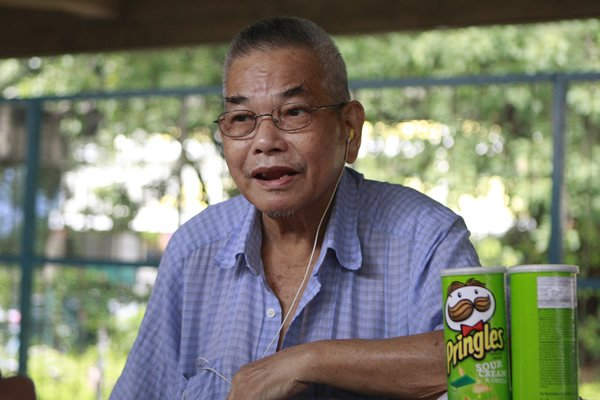 98-year-old snack seller Low Her Kee has watched small boys grow into 50-year-old married men. (Yahoo! photo/Marianne Tan)