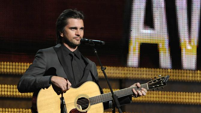 Juanes performs at the 55th annual Grammy Awards on Sunday, Feb. 10, 2013, in Los Angeles. (Photo by John Shearer/Invision/AP)