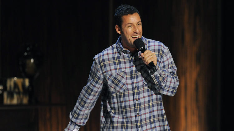 "Comedian Adam Sandler performs at ""Eddie Murphy: One Night Only,"" a celebration of Murphy's career at the Saban Theater on Saturday, Nov. 3, 2012, in Beverly Hills, Calif. (Photo by Chris Pizzello/Invision)"
