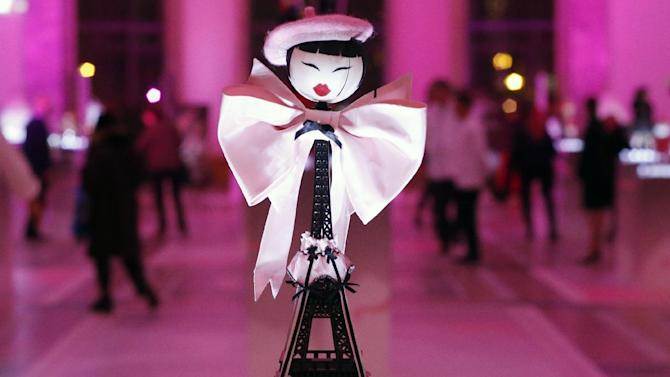 A creation designed by Chantal Thomass displayed at the Petit Palais, in Paris, Monday Nov. 25, 2013. The world's top fashion houses from Chanel, Prada and Christian Dior have brought together their needlework in a unique charitable venture: each designing children's dolls that will be sold at auction for UNICEF.(AP Photo/Francois Mori)