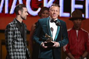Ryan Lewis, left, and Macklemore accept the award for …