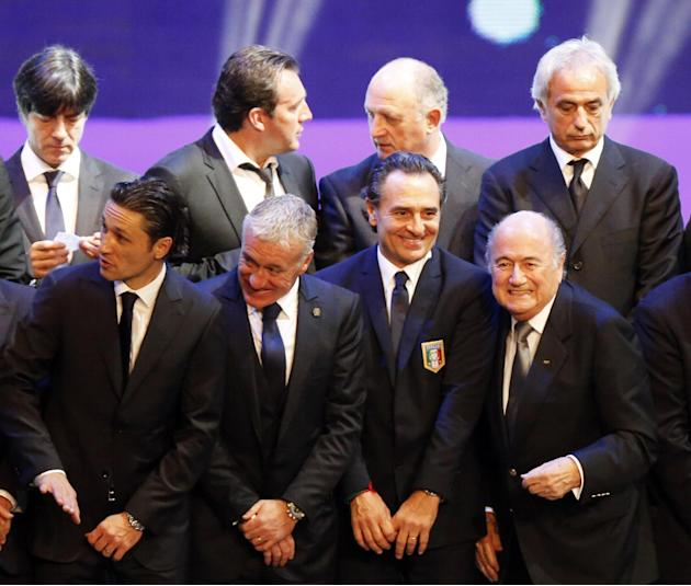 FIFA President Blatter smiles alongside Italy's coach Prandelli and France's coach Deschamps during their group photo after the draw for the 2014 World Cup finals was made at the Costa do Saui