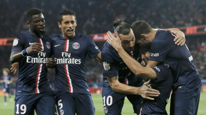 Paris St Germain's Cavani reacts after he scored against Olympique Lyon during their French Ligue 1 soccer match at the Parc des Princes Stadium in Paris