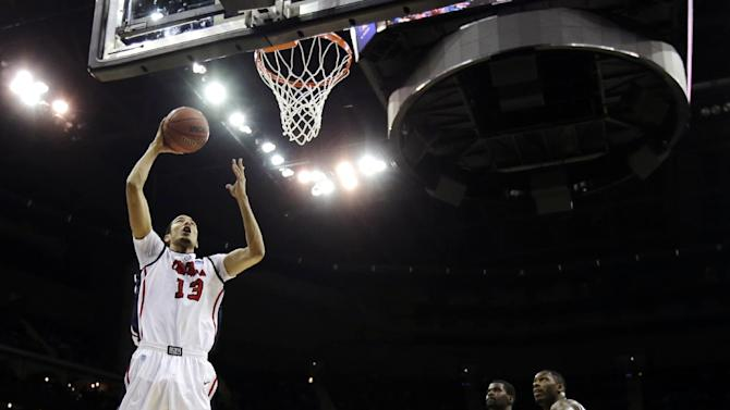 Mississippi forward Anthony Perez (13) shoots during the first half of a third-round game against La Salle in the NCAA college basketball tournament, Sunday, March 24, 2013, in Kansas City, Mo. (AP Photo/Charlie Riedel)