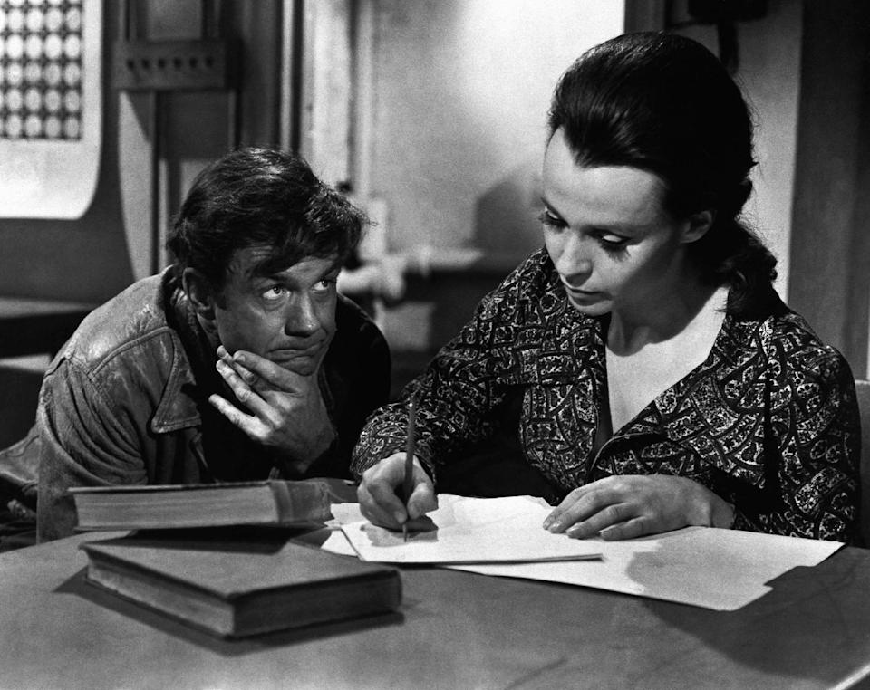 "In this Nov. 1975 photo provided by ABC-TV, Cliff Robertson plays a mentally retarded man who falls in love with his teacher, portrayed by Claire Bloom, after brain surgery raised him temporarily to genius level in ""Charly."" Robertson died Saturday, Sept. 10, 2011. He was 88. (AP Photo)"