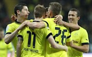 Dortmund's players celebrate after scoring a goal during their German first division Bundesliga match against Eintracht Frankfurt, in Frankfurt am Main, central Germany, on September 25. Reigning champions Dortmund go into their showdown against Borussia Moenchengladbach on Saturday admitting their defensive weaknesses are proving to be fatal