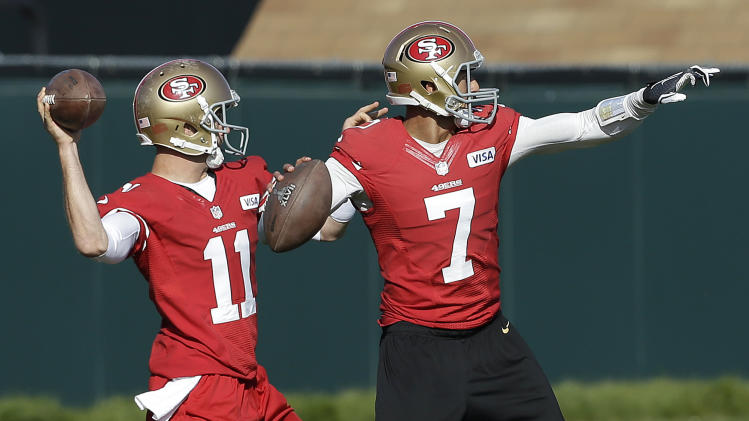 San Francisco 49ers quarterbacks Alex Smith (11) and Colin Kaepernick (7) practice at an NFL football training facility in Santa Clara, Calif., Friday, Jan. 25, 2013. The 49ers are scheduled to play the Baltimore Ravens in the Super Bowl on Sunday, Feb. 3. (AP Photo/Jeff Chiu)