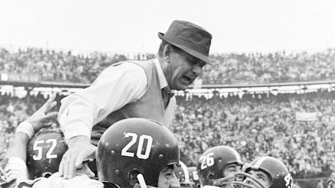 "FILE- In tis Jan. 2, 1967 file photo, Alabama coach Paul ""Bear"" Bryant gets a ride on the shoulders of his team after Alabama beat Nebraska 34-7 in the Sugar Bowl NCAA college football game in New Orleans. At a time when college football was generally considered the domain of eastern blue bloods, Notre Dame and Alabama were upstart teams that gave blue collar fans a chance to tweak the elite. About 90 years later, the Fighting Irish and Crimson Tide are the elite - two of college football's signature programs, set to play a national championship next Monday in Miami that could break records for television viewership. (AP Photo/File)"