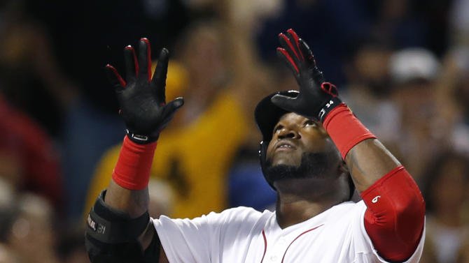 Boston Red Sox designated hitter David Ortiz celebrates his solo home run as he crosses the plate during the fourth inning of a baseball game against the Detroit Tigers at Fenway Park in Boston, Wednesday, Sept. 4, 2013. (AP Photo/Elise Amendola)