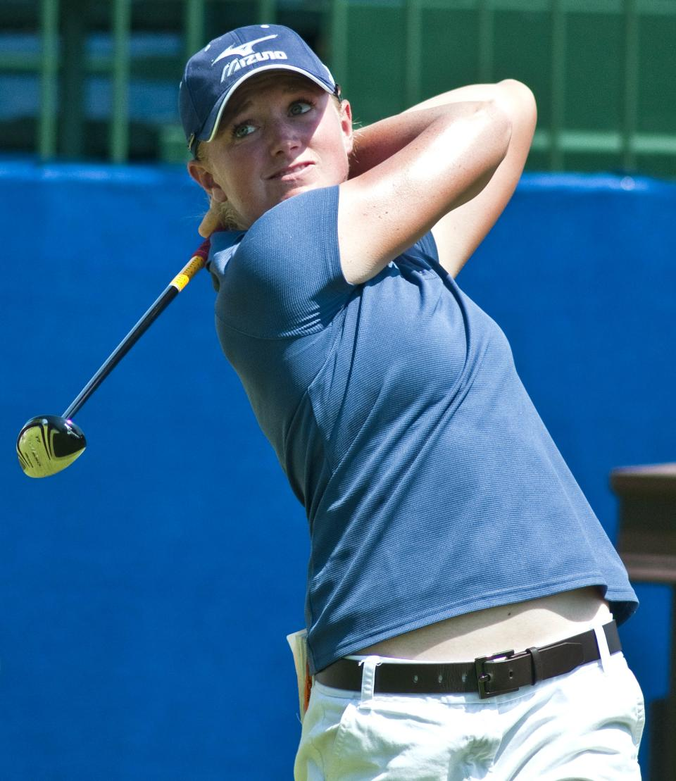 Stacy Lewis follows through on a shot on the first tee during the second round of the LPGA NW Arkansas Championship golf tournament in Rogers, Ark., Saturday, June 30, 2012. (AP Photo/April L. Brown)