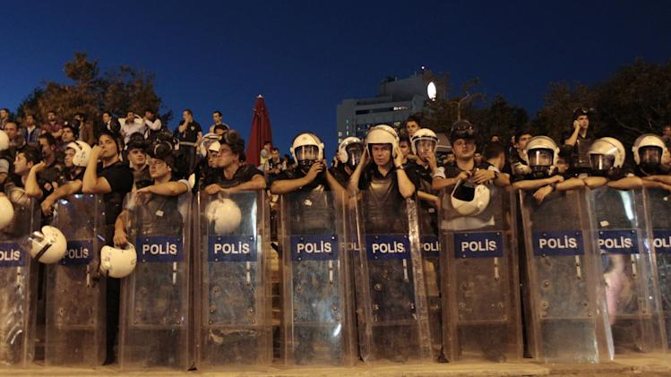 Riot police prepare during clashes with protesters at Taksim Square in Istanbul, Turkey, Saturday, June 22, 2013. (AP Photo/Petr David Josek)