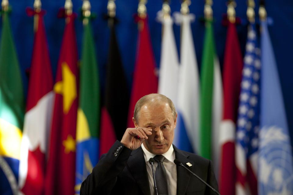 Russia's President Vladimir Putin pauses as he gives a press conference during the G20 summit in Los Cabos, Mexico, Tuesday, June 19, 2012. (AP Photo/Esteban Felix)