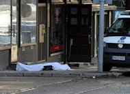 The body of a shooting victim lies covered with a sheet following multiple shootings by a gunman in Hyvinkaa, southern Finland. Police in Finland arrested an 18-year-old man on Saturday suspected of killing two people and wounding seven others in the overnight shooting in the south of the country