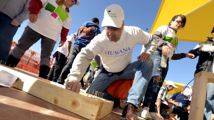 IMAGE DISTRIBUTED FOR HUMANA-Volunteer Daniel Montes, 63, of Meneffee, Calif., helps build a one-of-kind, multi-generational playground at the Boys & Girls Clubs of Coachella Valley, on Saturday, Jan. 12, 2013, in Desert Hot Springs, Calif. Nearly 400 volunteers joined The Humana Foundation, the philanthropic arm of Humana, Inc., one of the nation's leading health care companies; KaBOOM!, a national non-profit organization that has built more 2,200 playgrounds; the Boys & Girls Clubs of Coachella Valley and the City of Desert Hot Springs to build the playground in just six hours. The playground build is one of many wellness-focused activities taking place leading up to the 2013 Humana Challenge PGA TOUR golf tournament, which will be held Jan. 14-20, 2013, in La Quinta, Calif. The build is a direct result of people who wore Humana pedometers and logged their steps during the 2012 Humana Challenge Walkit program, in which every step counted toward the donation made by the Humana Foundation (Gabriel Acosta / AP Images for Humana).