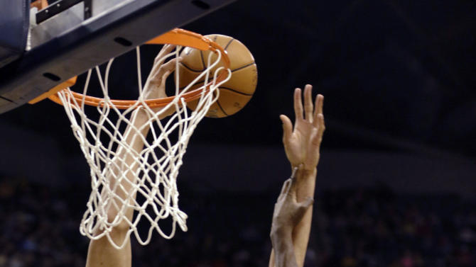 Denver Nuggets center JaVale McGee, left, is fouled by Indiana Pacers center Ian Mahinmi during the first half of an NBA basketball game in Indianapolis, Friday, Dec. 7, 2012. (AP Photo/AJ Mast)
