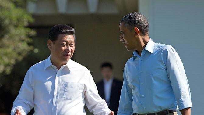 "President Barack Obama and Chinese President Xi Jinping, left, walk at the Annenberg Retreat of the Sunnylands estate Saturday, June 8, 2013, in Rancho Mirage, Calif. Obama told reporters his meetings with Xi have been ""terrific,"" while saying it is critical that the U.S. and China reach a ""firm understanding"" on cyber issues. (AP Photo/Evan Vucci)"