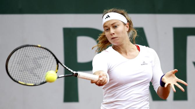 Stefanie Voegele of Switzerland plays a shot to Vitalia Diatchenko of Russia during their women's singles match at the French Open tennis tournament at the Roland Garros stadium in Paris