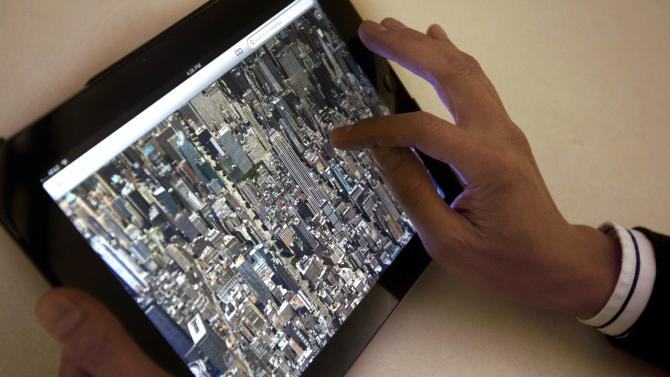 The new Apple Maps application is demonstrated in New York on Thursday, Sept. 20, 2012. Apple released an update to its iPhone and iPad operating system on Wednesday that replaces Google Maps with Apple's own application. Early upgraders are reporting that the new maps are less detailed, look weird and misplace landmarks. It's shaping up to be a rare setback for Apple. (AP Photo/Karly Domb Sadof)