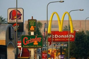 Fast-food restaurant line the streets in the Figueroa Corridor area of South Los Angeles.