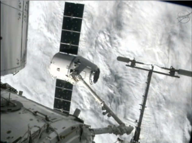 This image from NASA-TV shows the capture of the Dragon capsule by a robot arm on the International Space Station as they passed over the South Atlantic Ocean early Wednesday Oct. 10, 2012. It's the f