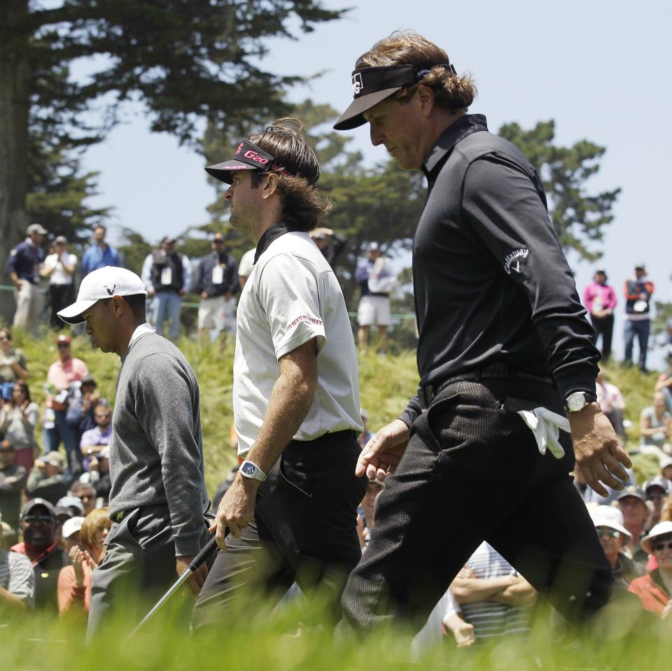 Tiger Woods, left to right, Bubba Watson and Phil Mickelson walk up the 18th hole during the first round of the U.S. Open Championship golf tournament Thursday, June 14, 2012, at The Olympic Club in San Francisco. (AP Photo/Charlie Riedel)