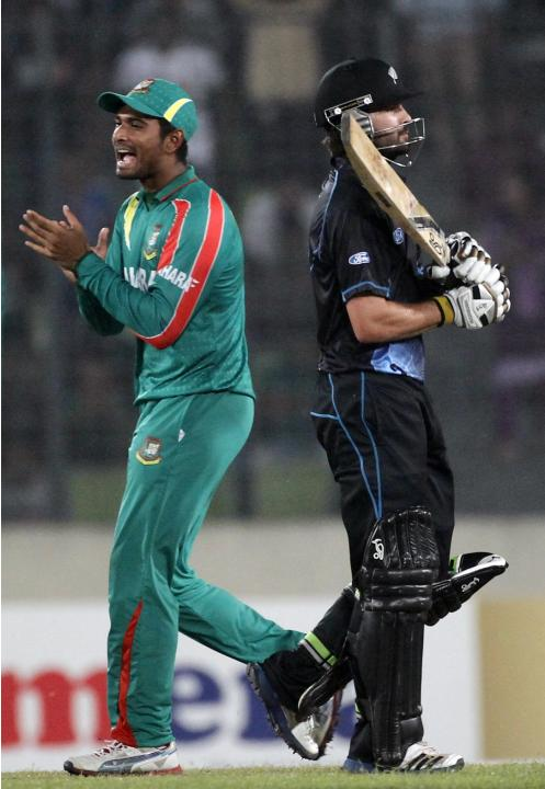New Zealand's Anton Devcich leaves the field as Bangladesh's Mahmudullah celebrates his dismissal during their second ODI cricket match in Dhaka