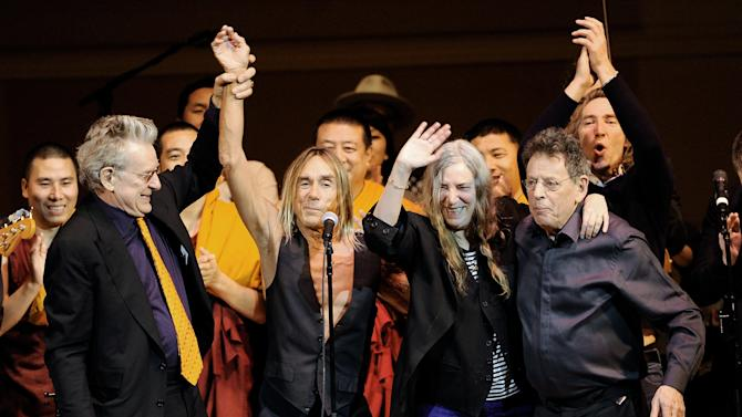 Co-founder of Tibet House U.S. Robert Thurman, left, singer Patti Smith, musician Iggy Pop and composer Philip Glass celebrate during the finale at the 24th Annual Tibet House U.S. benefit concert at Carnegie Hall on Tuesday, March 11, 2014 in New York. (Photo by Evan Agostini/Invision/AP)