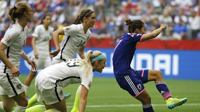 Japan's Yuki Ogimi, right, scores a goal as United States' Julie Johnston, (19) and other players look on during the first half of the FIFA Women's World Cup soccer championship in Vancouver, British Columbia, Canada, Sunday, July 5, 2015. (AP Photo/Elaine Thompson)