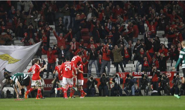 Benfica players celebrate a goal against Sporting during their Portuguese Premier League soccer match at Luz stadium in Lisbon