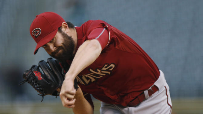 Arizona Diamondbacks starting pitcher Robbie Ray works against the Colorado Rockies in the first inning of the second game of a baseball doubleheader Wednesday, May 6, 2015, in Denver. (AP Photo/David Zalubowski)