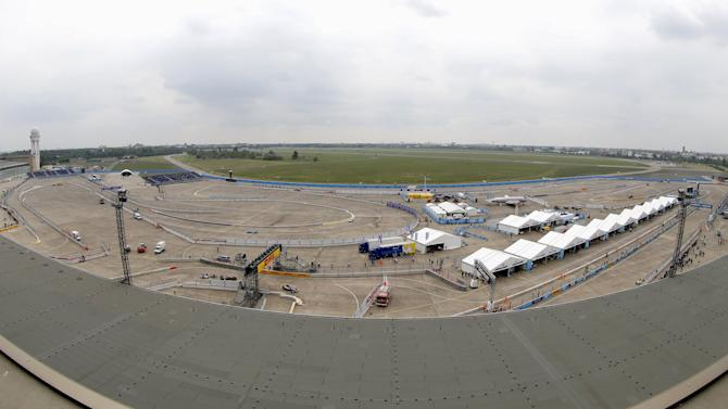A general view shows Formula E cars during their practice for a Championship race at former Tempelhof airport in Berlin