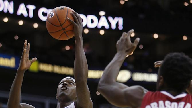 Arizona State guard Gerry Blakes (4) lays the ball up against Alabama guard Retin Obasohan (32) in the first half in the consolation game of the CBE Hall of Fame Classic college baseball tournament Tuesday, Nov. 25, 2014, in Kansas City, Mo. (AP Photo/Ed Zurga)