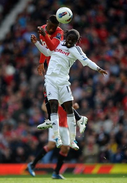 Patrice Evra of Manchester United competes in the air with Nathan Dyer of Swansea City during the Barclays Premier League match between Manchester United and Swansea City at Old Trafford on 6 May 2012 in Manchester, England. (Photo by Laurence Griffiths/Getty Images)