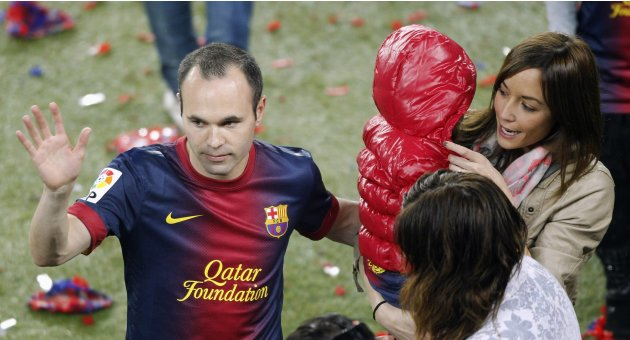Barcelona's Iniesta, his wife Ana and daughter Valeria are seen during the Spanish league first division trophy celebrations at Camp Nou stadium in Barcelona