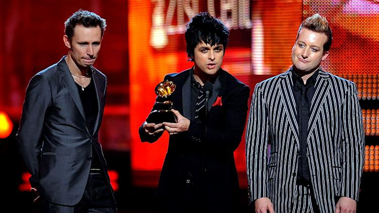 Mike Dirnt, Billie Joe Armstrong, and TrÈ Cool of Green Day receive an award at The 52nd Annual Grammy Awards held at Staples Center on January 31, 2010 in Los Angeles, California.